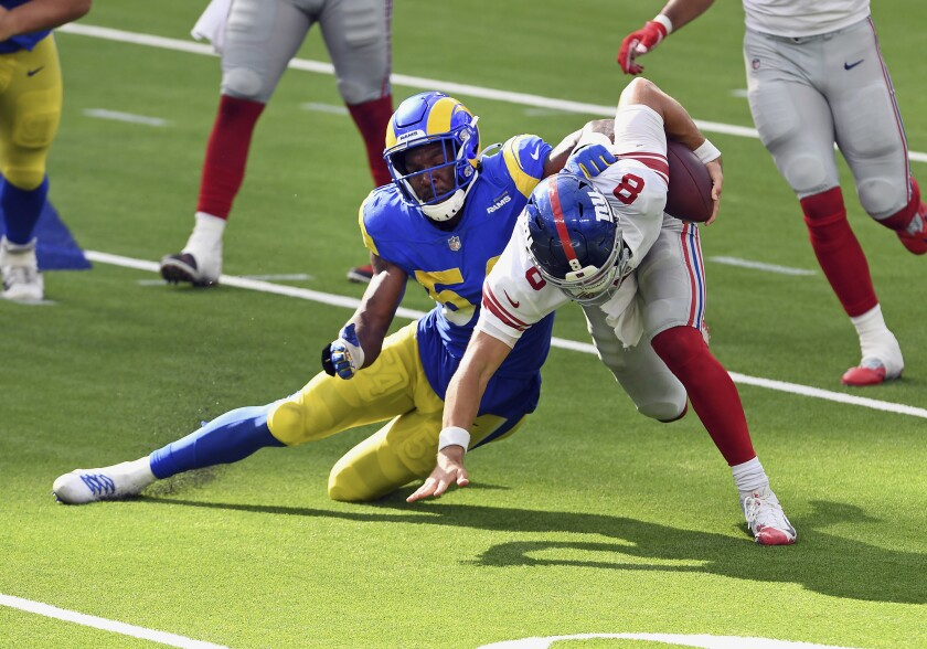 Rams outside linebacker Leonard Floyd brings down Giants quarterback Daniel Jones on Oct. 4.