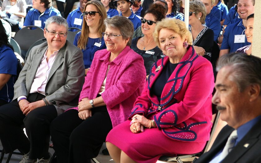In the front row of the audience at the g dedication ceremony for the Jan and Esther Stearns Center for ACE Scholars at Cal State University San Marcos are, left to right, Esther Stearns, her spouse Jan Stearns, and University President Karen Haynes. They are reacting to the acknowledgment of Jim