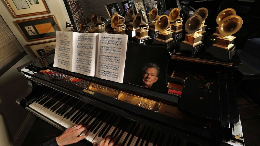 Foster's piano top holds his 16 Grammy Awards.