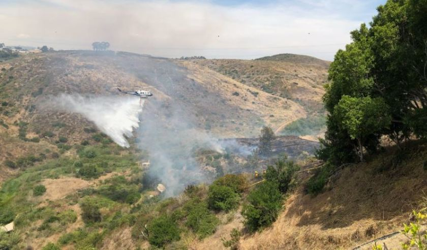 A fire ignited along the border of Rancho Santa Fe and the Fairbanks Ranch community on Tuesday, June 11.