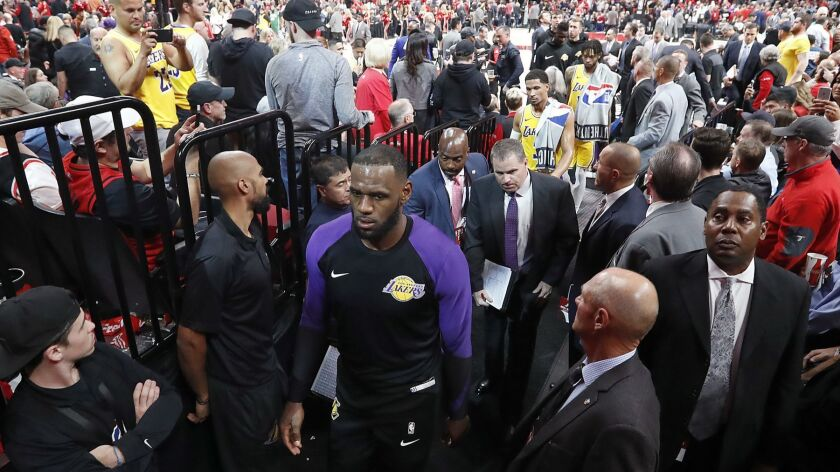 PORTLAND, ORE. . - OCT. 18, 2018. Laker forward LeBron James heads to the locker room at halftimeof