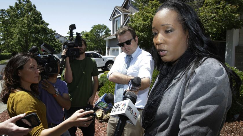 Ina Rogers talks with reporters about the seizure of her 10 children by law enforcement Monday, May