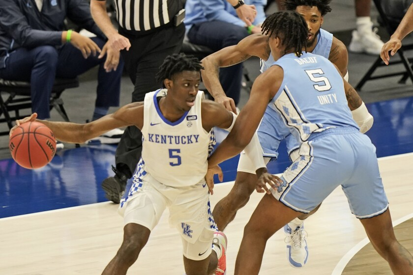 Kentucky's Terrence Clarke drives past North Carolina's Armando Bacot.