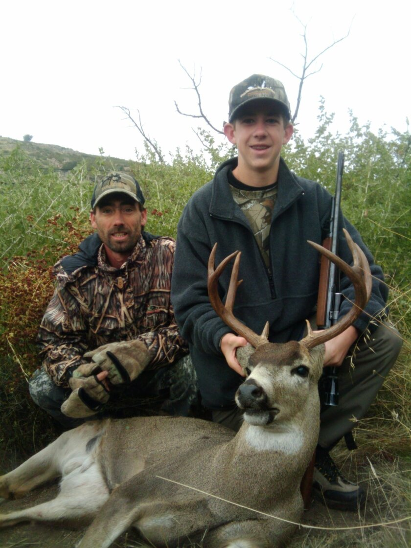 Cedar Hobbs, 14, shot this 3x4 buck with his uncle Noah Hobbs' (pictured) Weatherby 300-magnum rifle. The second week of the deer season in San Diego County for rifle hunters began Saturday.