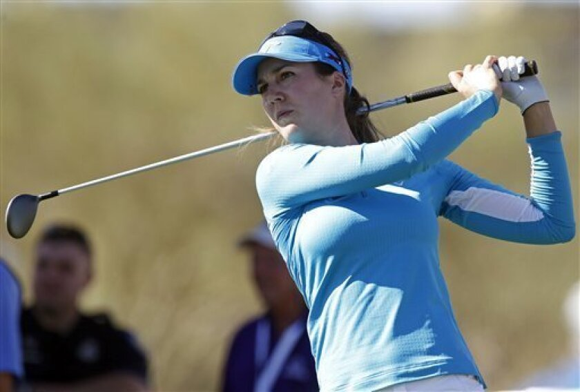 Sandra Gal, of Germany, hits off the 10th tee during the first round of the Founders Cup golf tournament on Thursday, March 14, 2013, in Scottsdale, Ariz. (AP Photo/Paul Connors)