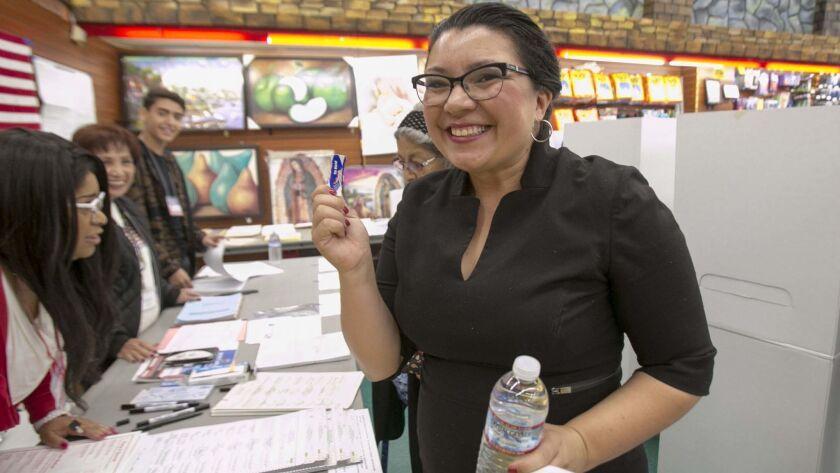 "Alejandra Sotelo-Solis, a candidate for mayor of National City, showed off her ""Yo Voté"" sticker after voting at the Food Bowl supermarket."