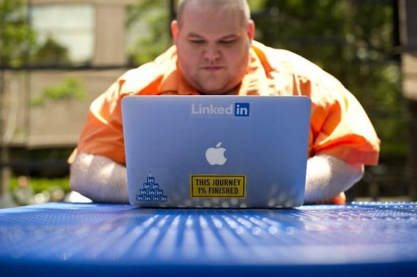 A LinkedIn employee works outside