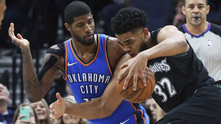 Paul George's defense, on display here against Timberwolves center Karl-Anthony Towns, is just as potent as his offense.