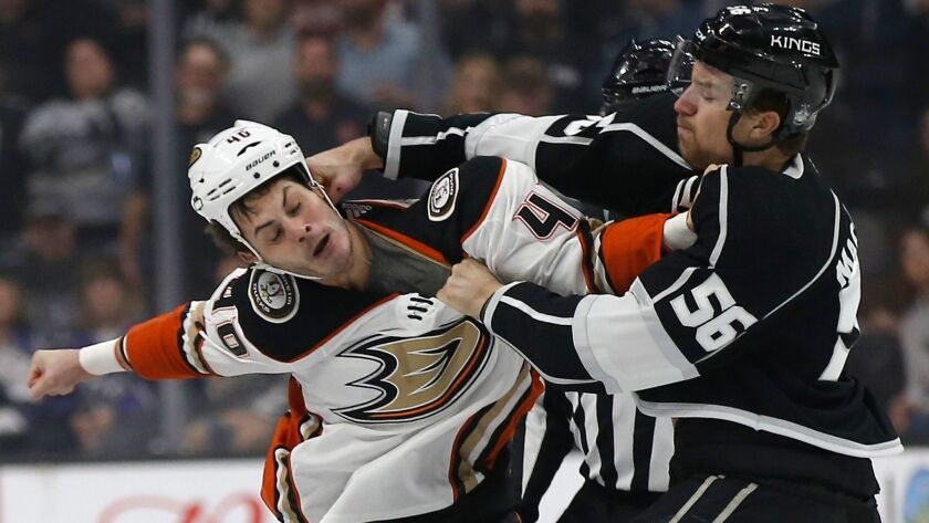 Los Angeles Kings defenseman Kurtis MacDermid fights with Anaheim Ducks right wing Jared Boll during the first period.