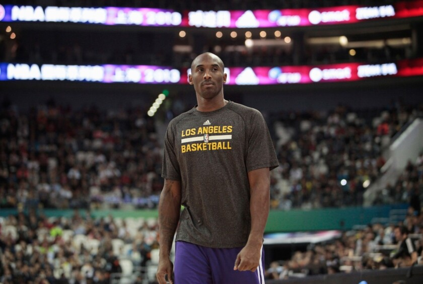 Lakers players found out on flight back to Los Angeles from Philadelphia that Kobe Bryant had been killed in a helicopter crash.