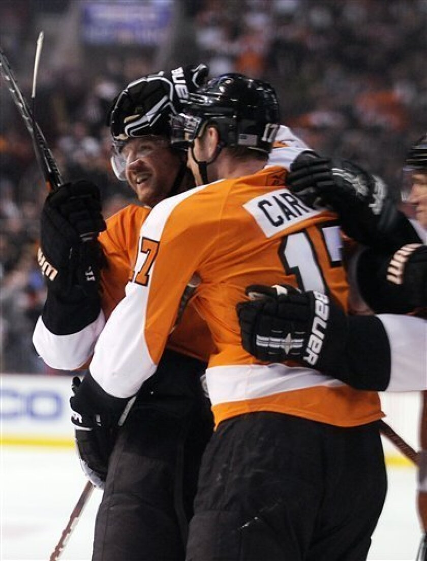 Philadelphia Flyers forward Scott Hartnell, left, celebrates with Jeff Carter after Carter's goal in the second period of an NHL hockey game against the New Jersey Devils Monday, Feb. 8, 2010, in Philadelphia. (AP Photo/Michael Perez)