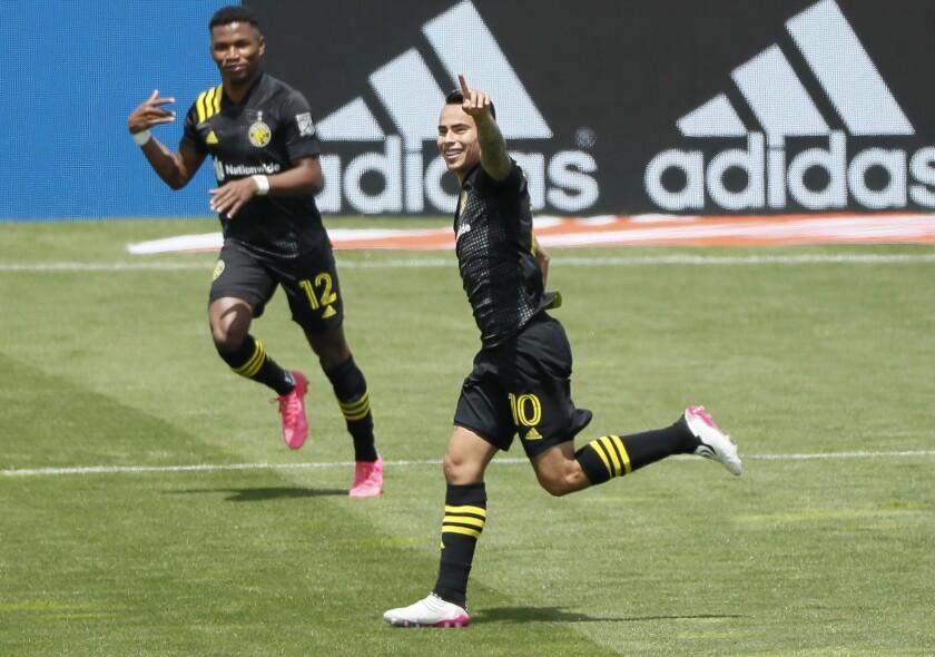 Columbus Crew SC midfielder Lucas Zelarrayan (10) celebrates a goal against D.C. United during an MLS soccer game at Historic Crew Stadium in Columbus, Ohio, Saturday, May 8, 2021. (Adam Cairns/The Columbus Dispatch via AP)