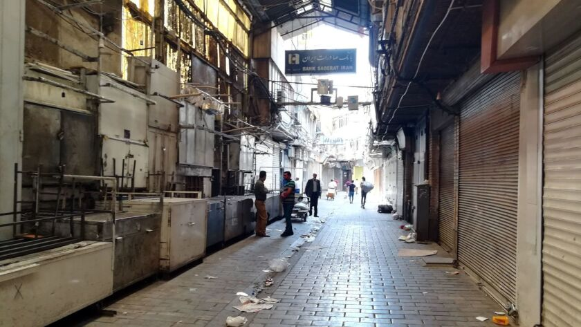 Shops in Tehran's Grand Bazaar are closed as traders protest rising prices and the weakening of Iran's currency.