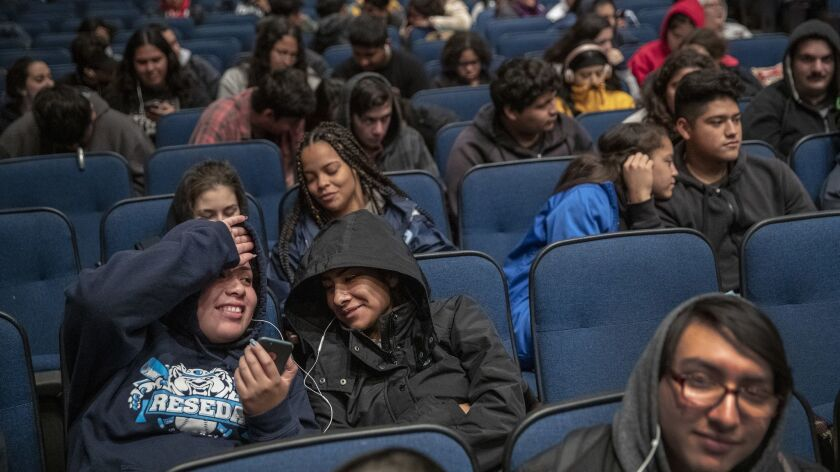 Reseda High students Guadalupe Gonzalez, 18, left, and friend Xiomara Garcia, 17, right, sit in the school auditorium as UTLA teachers are out on strike.