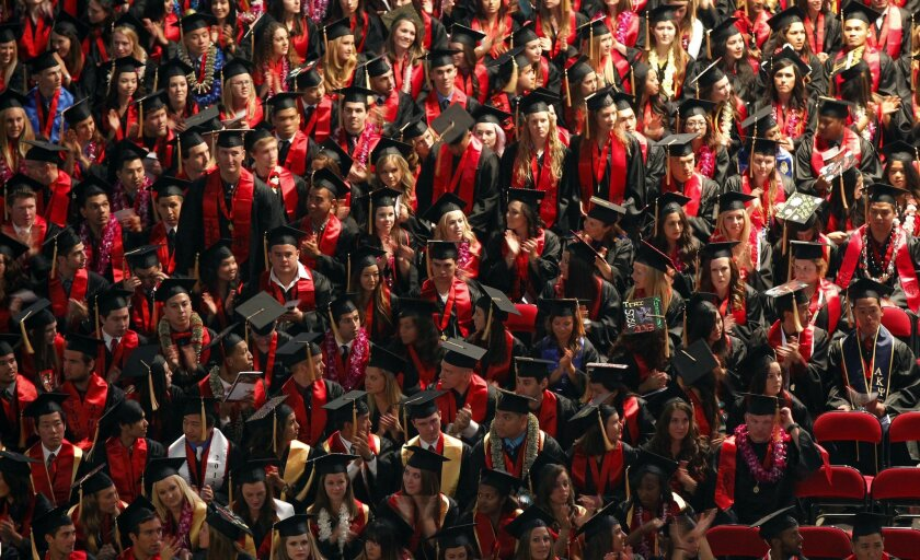 SDSU students from the College of Health and Human Services listen during their graduation at Viejas Arena in 2013.
