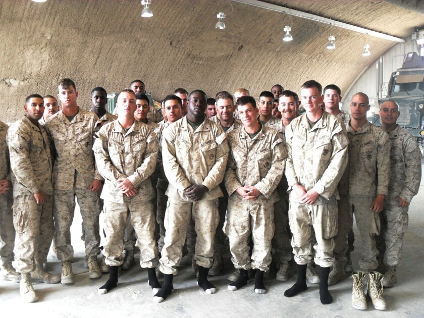 Marine combat engineers in Afghanistan show off their new socks that were sent to them via Socks for Heroes.