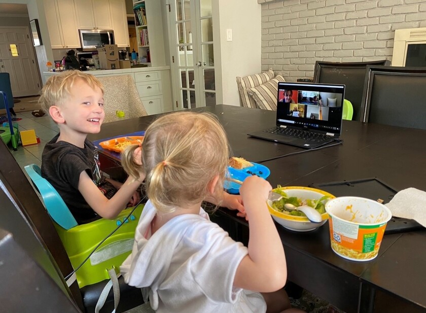Five-year-old Cadman Coller participated in a distance learning lesson next to Emma, his 3-year-old sister, last spring.