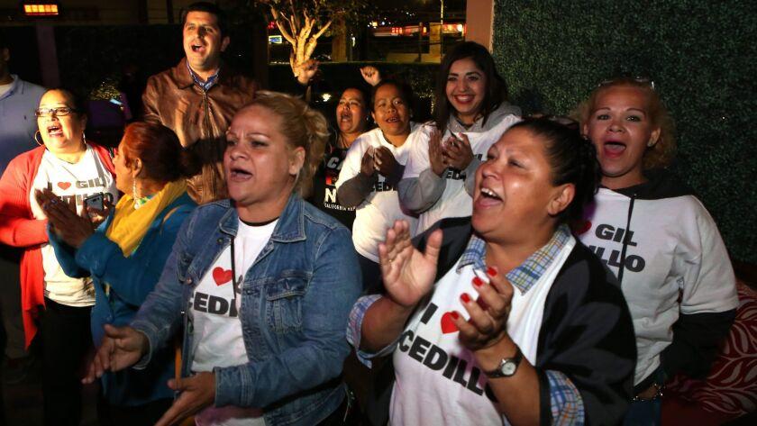Supporters of City Councilman Gil Cedillo celebrate during his election night party. Cedillo easily