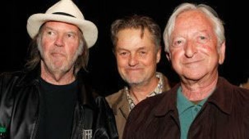TORONTO, ON - SEPTEMBER 12: (L-R) Musician Neil Young, director Jonathan Demme, and manager Elliot