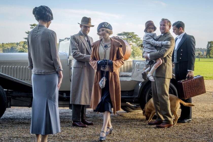 "This image released by Focus Features shows Elizabeth McGovern, from left, Harry Hadden-Paton, Laura Carmichael, Hugh Bonneville and Michael Fox, right, in a scene from the film ""Downton Abbey."" (Jaap Buitendijk/Focus Features via AP)"
