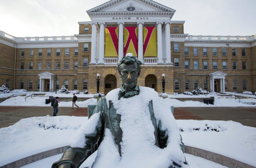 This Feb. 4, 2015, photo shows a Abraham Lincoln statue on Bascom Hill on the University of Wisconsin-Madison campus in Madison, Wis. The University of Wisconsin System regents are pushing back against Republican Gov. Scott Walker's proposed budget cuts. (AP Photo/Wisconsin State Journal, Steve App