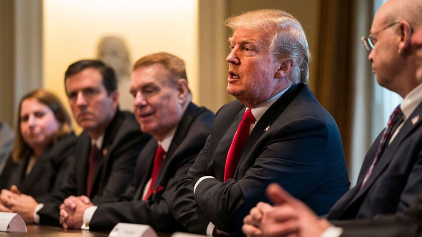 President Trump speaks during a meeting with leaders from the steel and aluminum manufacturing industries at the White House.