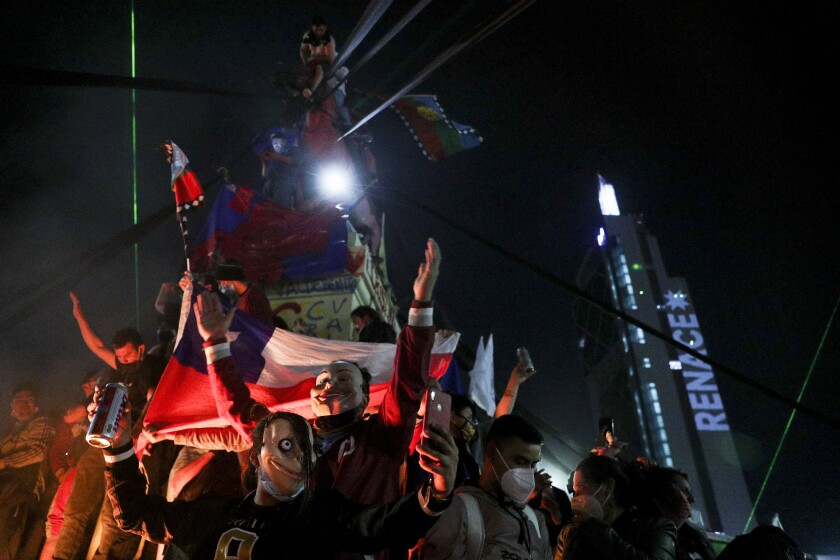 People gather in Santiago, Chile, on Sunday, when Chileans voted to rewrite the country's 40-year-old constitution