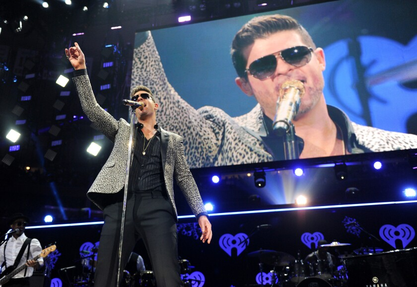 Robin Thicke performs at Z100's Jingle Ball 2013 at Madison Square Garden on Friday in New York.