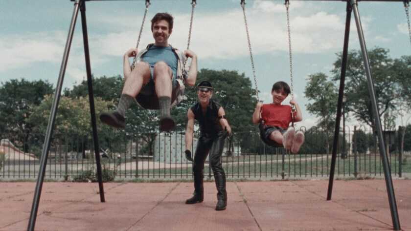 """Mark Blane, Christian Patrick and Joseph Seuffert play on a swingset in the movie """"Cubby."""""""