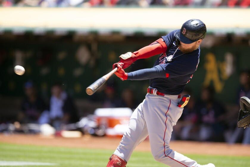 Boston Red Sox's Alex Verdugo (99) connects for a double against the Oakland Athletics during the third inning of a baseball game, Sunday, July 4, 2021, in Oakland, Calif. (AP Photo/D. Ross Cameron)