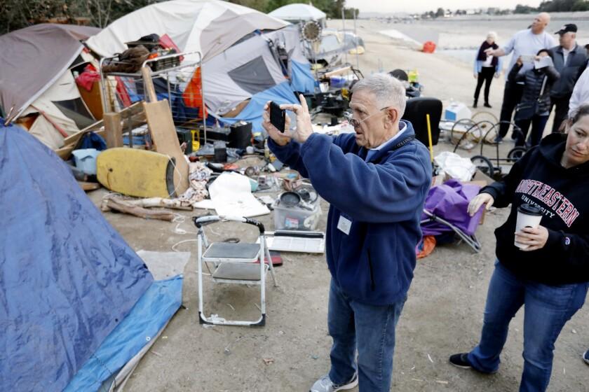 Judge visits homeless encampment