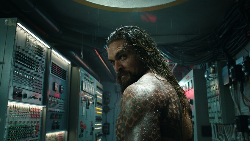 """This image released by Warner Bros. Pictures shows Jason Momoa in a scene from """"Aquaman."""" (Warner Br"""