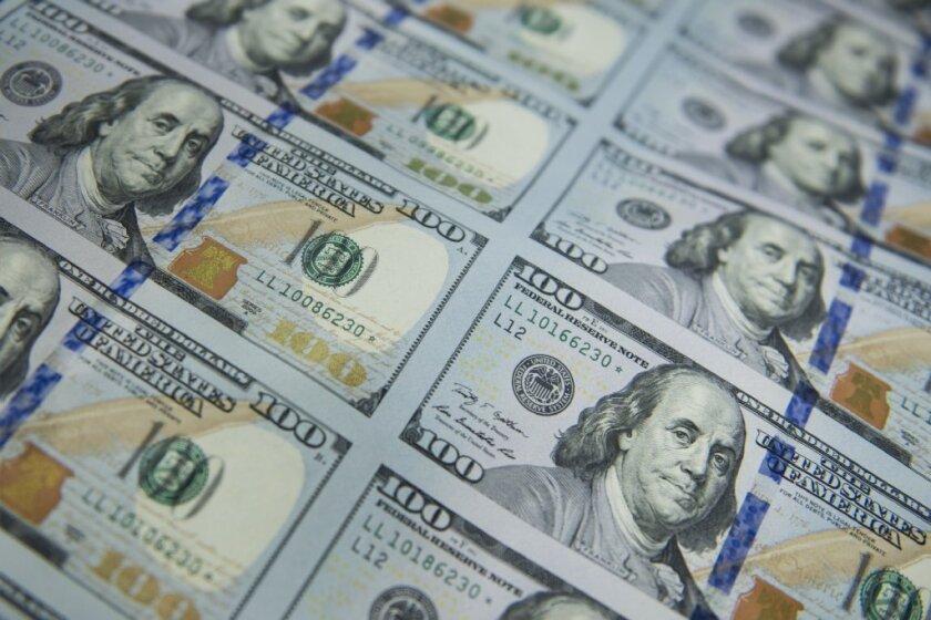 Rows of $100 bills