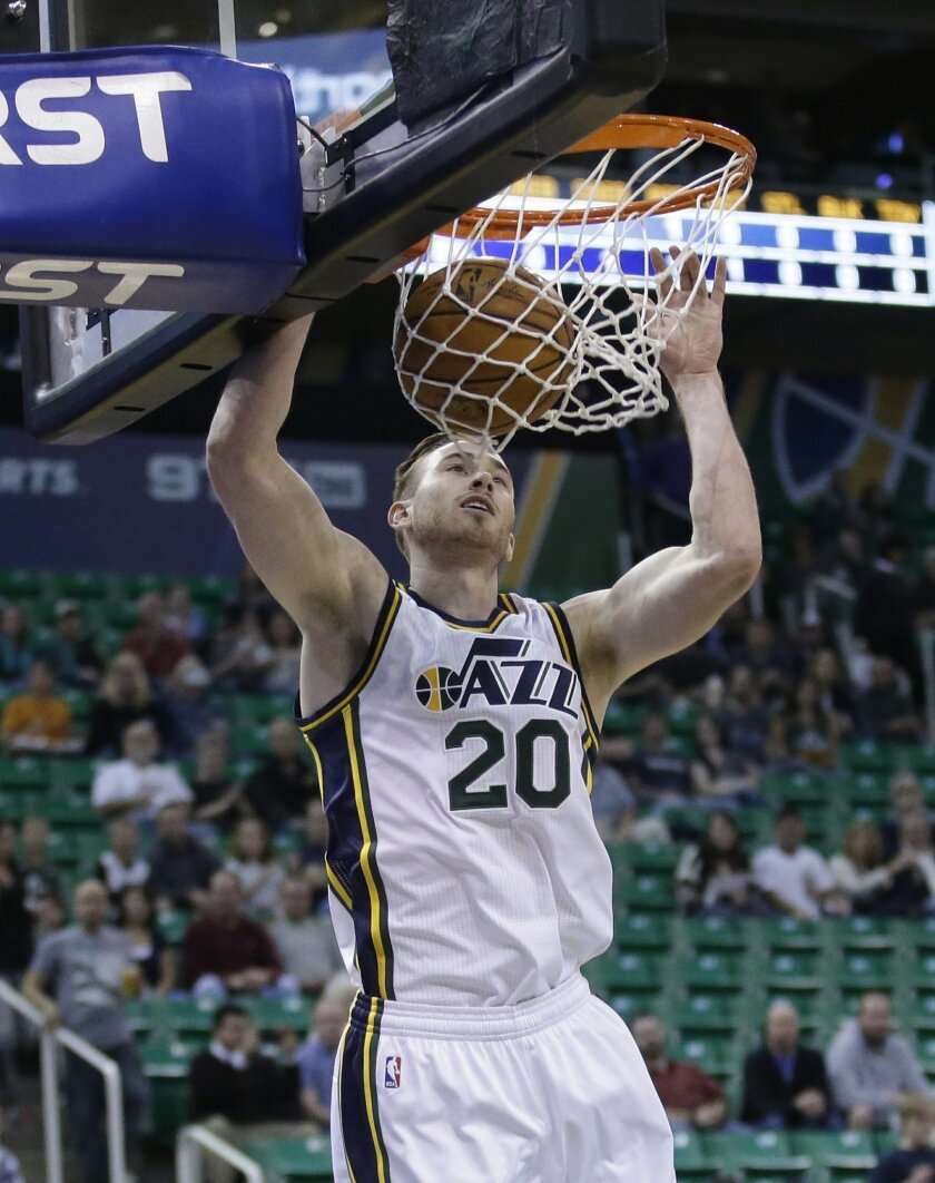FILE - This Oct. 22, 2015, file photo, shows Utah Jazz guard Gordon Hayward (20) dunking the ball in the first quarter during NBA preseason basketball game against the Denver Nuggets, in Salt Lake City. Hayward is off to a slow start in a year he expected to prove he's one of the best of the game.
