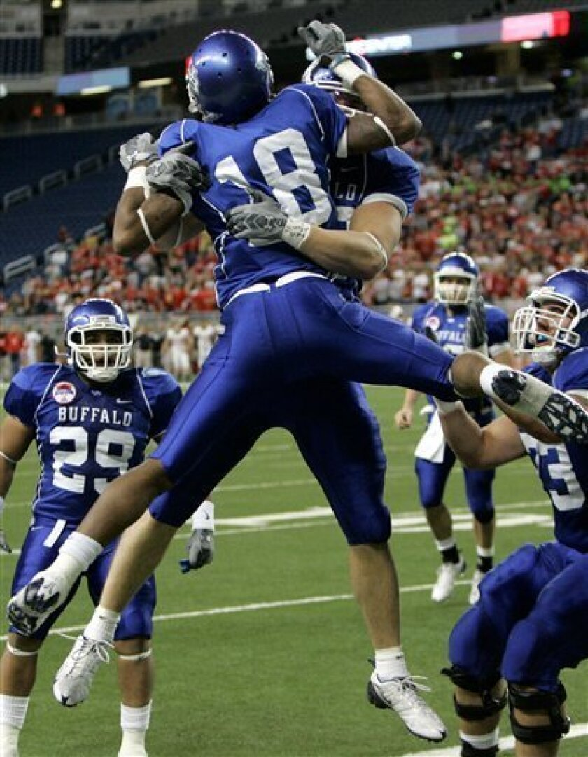 Buffalo receiver Naaman Roosevelt (18) celebrates with teammates after his first quarter touchdown during the Mid-American Conference NCAA championship football game against Ball State at Ford Field in Detroit, Friday, Dec. 5, 2008. (AP Photo/Carlos Osorio)