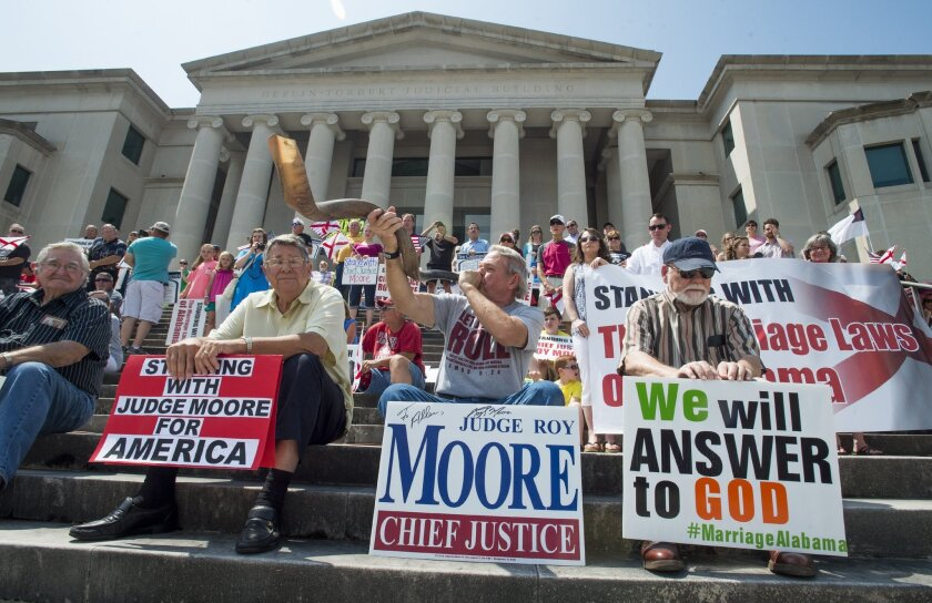 Allen Screws blows the shofar as hundreds gather for a rally in support of embattled Alabama Chief Justice Roy Moore on the steps of the Alabama Judicial Building in Montgomery, Ala., Saturday, May 21, 2016. Speakers led prayers and urged those at the rally Saturday to sign an online petition suppo