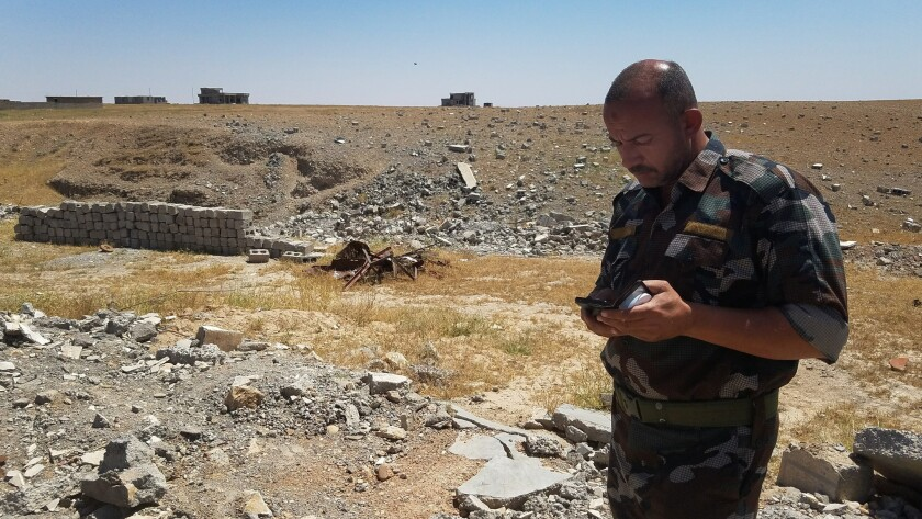 Sunni tribal commander Abdul Kareem Ahmed Shahab visited the house where he said 18 fighters were ki