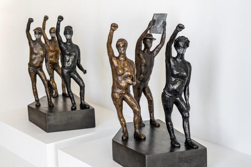 "Manuelita Brown: ""Uphill Struggle,"" 2020. Bronze with wood base, 16.5"" x 14.25"" x 9"""