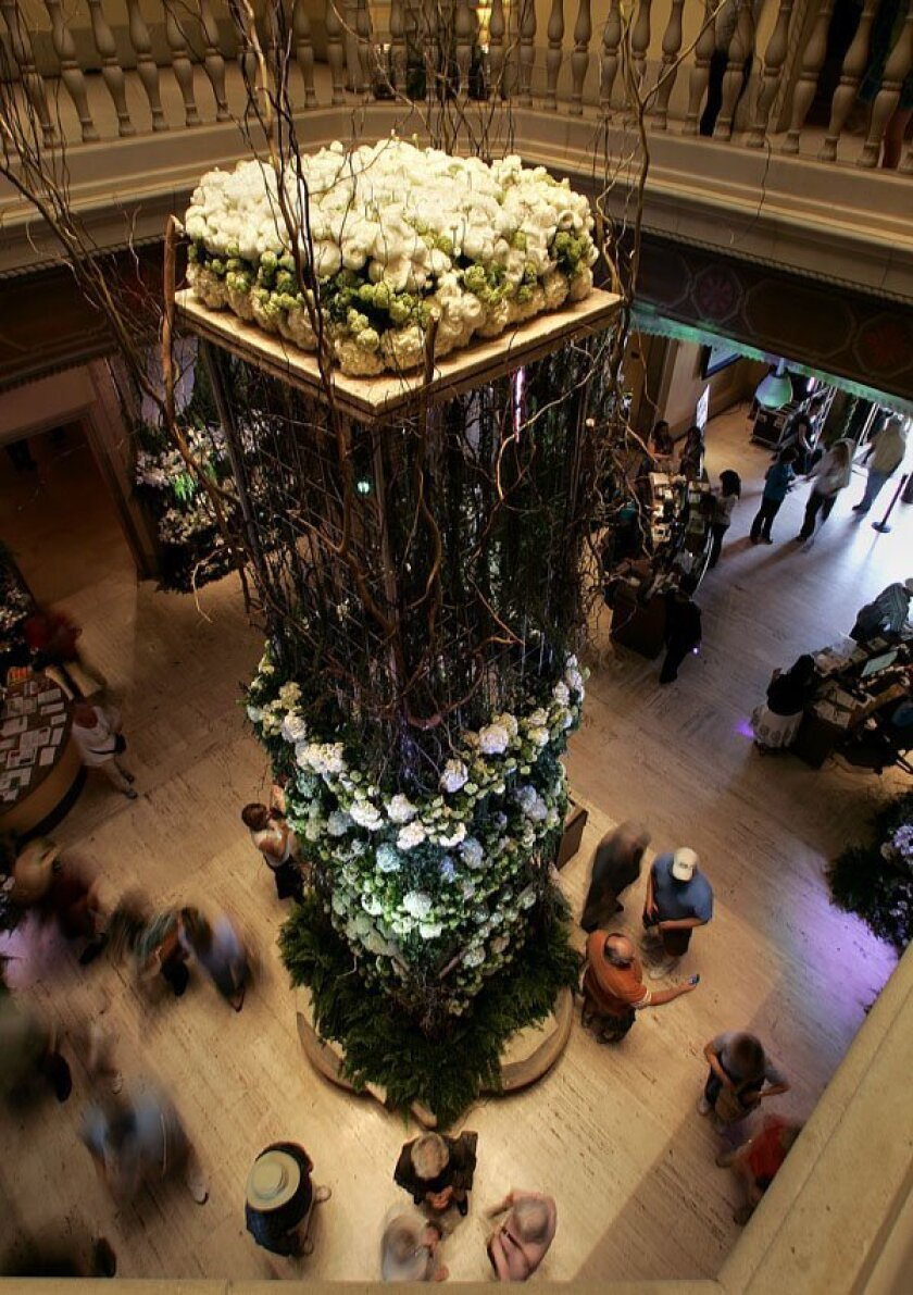 Art Alive pairs floral design with the museum's works making a wonder for the senses. Rene Van Rems who designed the art in the museum's rotunda had the help of 40 volunteers to set the more than 50,000 stemmed flowers for the event.