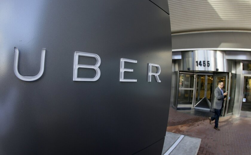 A man leaves the headquarters of Uber in San Francisco.