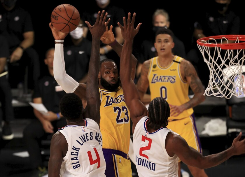Lakers forward LeBron James is double-teamed in the fourth quarter Thursday.