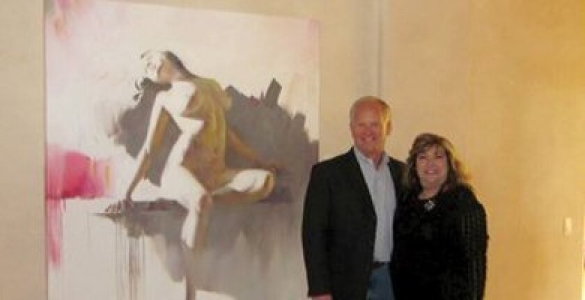 May Zawaideh and Stephen Sheedy with the Akaaby painting. Photos courtesy Marybeth Kellehee