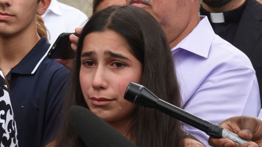 FILE - In this June 16, 2017 file photo, Lindsey Hamama, 11, right, cries as her mother Nahrain spea