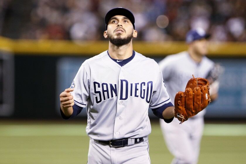 Padres pitcher Javy Guerra, a converted shortstop, walks off the field in the eighth inning of a baseball game against the Arizona Diamondbacks on the final day of the 2019 season.