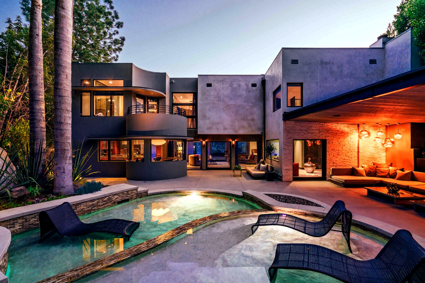 """Two years after bringing it to market, """"American Idol"""" alum Adam Lambert found a buyer for his Hollywood Home. The subdued contemporary home, which features a resort-like backyard, sold for $2.92 million, or $75,000 less than what Lambert paid in 2014. The home has roughly 3,000 square feet of living space, an indoor-outdoor living room and a dining room with a wine closet. A guest suite was used by Lambert as a music room."""