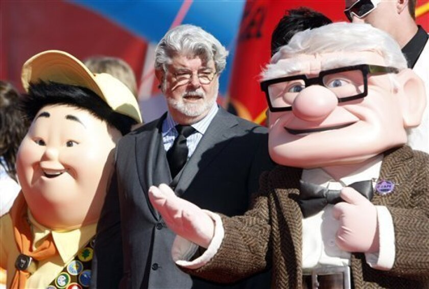 Film director George Lucas flanked by characters from animated movie upon arrival for the presentation of the Golden Lion for life-time achievements at the 66th edition of the Venice Film Festival in Venice, Italy, Sunday, Sept. 6, 2009. (AP Photo/Andrew Medichini)