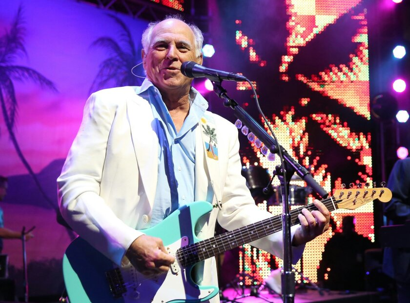 """FILE - In this June 9, 2015 file photo, Jimmy Buffett performs at the after party for the premiere of """"Jurassic World"""" in Los Angeles. Producers said Thursday, Dec. 17,  that a planned Jimmy Buffet musical will have Buffett's blend of rock and country tunes and an original story by writers Greg Gar"""