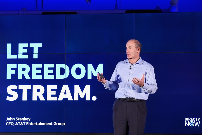 John Stankey, chief executive of the AT&T Entertainment Group, unveils the DirecTV Now streaming service Monday in New York.