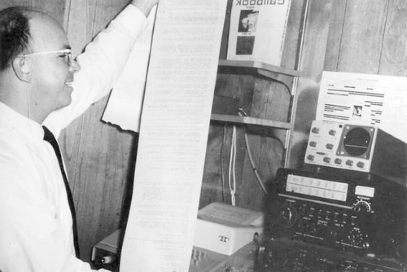 """James Marsters, in his Pasadena home, reads a printout from the technology he helped create. He conceived the idea and championed its use, according to the 1995 edition of """"Deaf Persons in the Arts and Sciences."""""""