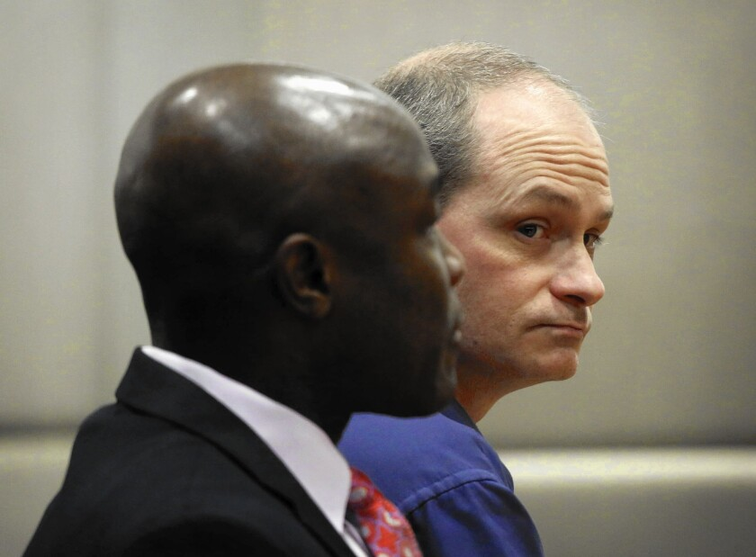 Nathan Louis Campbell, right, with defense attorney James Cooper, has pleaded not guilty to murder, assault with a deadly weapon and hit-and-run charges.